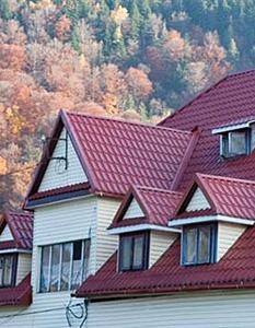 Дом с кровлей из металлочерепицы Ruukki Monterrey Premium